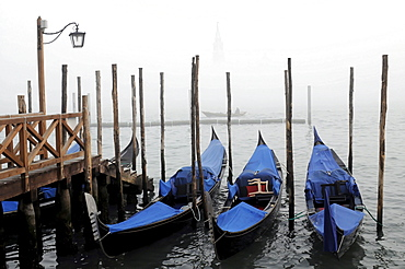 Gondolas in the fog at St. Mark's Square, Venice, Veneto, Italy, Europe