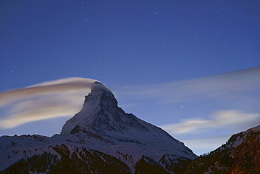 Starry sky above Matterhorn mountain, canton of Valais, Switzerland, Europe