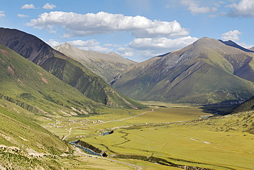 View from Drigung Til Monastery of the valley and the surrounding mountains, Tibet, China, Asia