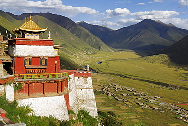 View of the valley and the golden roofs of Drigung Til Monastery, Tibet, China, Asia