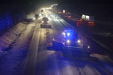 Winter service vehicles in service on the A8 motorway at the Stuttgart junction near Stuttgart-Rohr, Stuttgart, Baden-Wuerttemberg, Germany, Europe