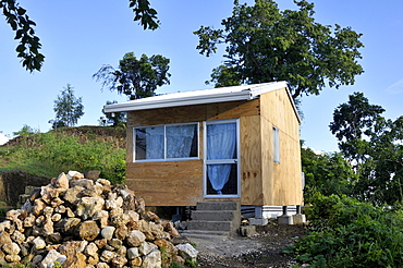 Earthquake-proof prefab home that was given to the victims of the January 2010 earthquake as part of a reconstruction programme by an international aid organisation, Palmiste-a-Vin, Leogane, Haiti, Caribbean, Central America