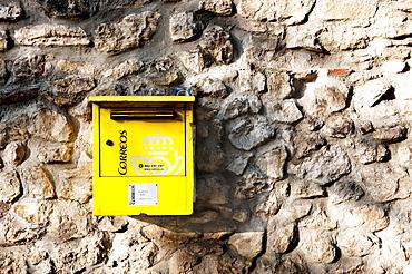Mailbox of the Spanish post Correos on a stone wall, Santillana del Mar, Cantabria, Northern Spain, Spain, Europe