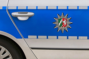 Coat of arms of North Rhine-Westphalia on a blue police car