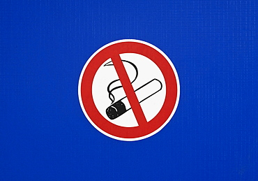 No smoking sign on a blue surface