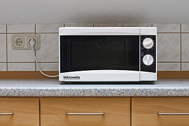 Microwave on a kitchen counter