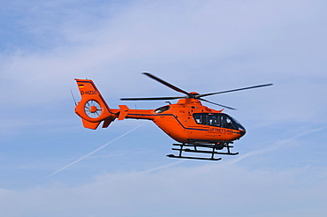 Orange helicopter of the air rescue in flight, rescue helicopter Christoph 3