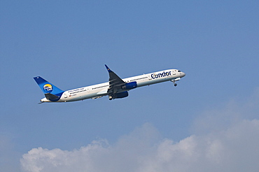 Aircraft of Thomas Cook airline, Condor airline, during take-off, Boeing 757-300 WL, with Peanuts-comic characters Snoopy and Woodstock painted on aircraft