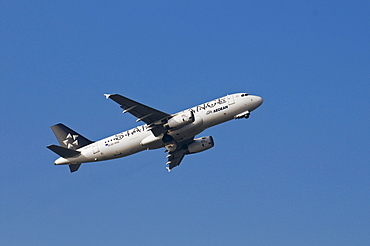 Star Alliance aircraft of Aegean Airlines shortly after take-off with landing gear closing, Airbus A32