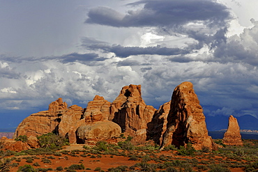 Rock formations of Turret Arch, rock arch, dramatic clouds, Arches National Park, Moab, Utah, Southwestern United States, United States of America, USA