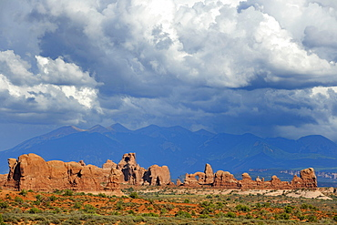 Rock formations of Turret Arch, rock arch, Elephant Butte, North Window, South Window, La Sal Mountains at the back, dramatic clouds, Arches National Park, Moab, Utah, Southwestern United States, United States of America, USA