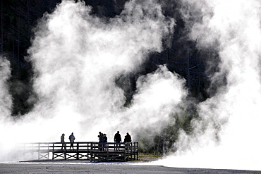 Tourists on a boardwalk amidst the steam of the springs and geysers, Black Sand Basin, Upper Geyser Basin, Yellowstone National Park, Wyoming, United States of America, USA