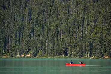 Tourists in a canoe, Lake Louise, Banff National Park, Canadian Rocky Mountains, Alberta, Canada