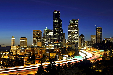 Night shot, Interstate 5 motorway in front of thw skyline of the Financial District in Seattle, Columbia Center, formerly known as Bank of America Tower, Washington Mutual Tower, Two Union Square Tower, Municipal Tower, formerly Key Tower, Smith Tower, Se