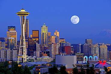 Night scene, skyline of the Financial District in Seattle with a full moon, Space Needle, Columbia Center, formerly known as Bank of America Tower, Washington Mutual Tower, Municipal Tower, formerly Key Tower, U.S. Bank Center, Washington, United States o