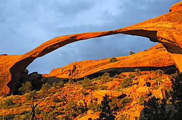 Landscape Arch rock formation in the morning in a stormy atmosphere, Arches National Park, Utah, United States, America