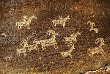 Petroglyphs of the native Americans, about 1500 years old, near Wolf Ranch, Arches National Park, Utah, USA