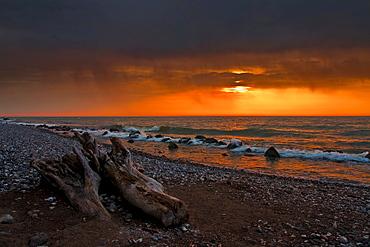 Beach at sunrise with rain clouds, Jasmund National Park, Ruegen, Mecklenburg-Western Pomerania, Germany, Europe