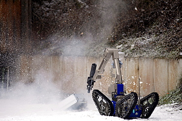 Radio control robot from the Telerob company to defuse explosives, bombs and other dangerous devices by remote control, the water gun uses extreme high pressure to render the explosive device unusable