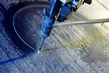 Water jet technology, precise technology for cutting metal with a high pressure water jet, where an abrasive material is added to the water, Waterjet company, Aarwangen, Switzerland, Europe