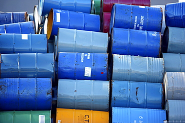 Empty metal drums used for chemicals stockpiled in a recycling company