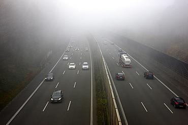 A52 motorway in thick fog, autumn, visibility below 100 metres, Essen, North Rhine-Westphalia, Germany, Europe