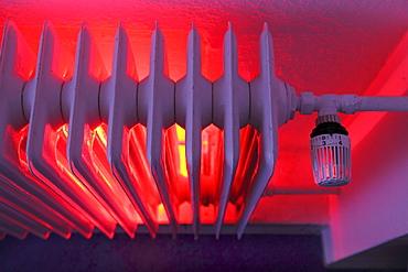 Radiator with thermostat, illuminated, heating costs