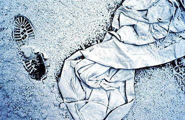 Discarded worker's clothing and a footprint, covered with hoarfrost, Huettenwerk Meiderich steel mill after closure, today Duisburg-Nord Landscape Park, North Rhine-Westphalia, Germany, Europe