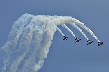 Stunt planes with smoke trails, Milwaukee, Wisconsin, USA, America