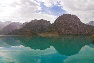 Turquoise Alexanderlake in Fan Mountains, Iskanderkul, Tajikistan