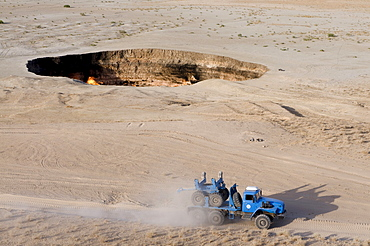 Cross-country vehicle driving on a dusty rural road, Darvaza Gas Crater, Turkmenistan, Central Asia