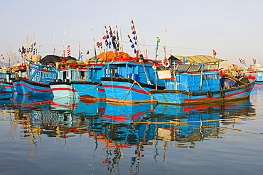 Blue fishing boats in the harbour of Nha Trang, Vietnam, Asia