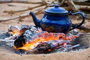 Teapot on campfire, Tadrat, Algeria, Africa