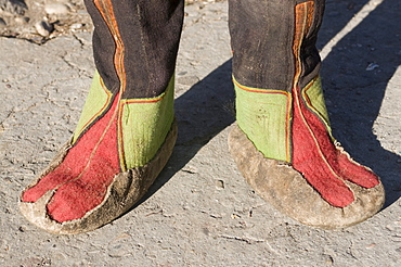Feet of monk in traditional costume, Paro, Bhutan, Asia