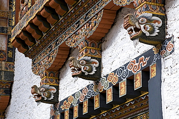Typical wooden facade with dragons on the Palace of Punakha, Dzong, Bhutan, Asia