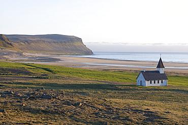 Kittel chapel in the bare landscape at turquoise coast, Westfjords, Breidavik, Iceland, Europe