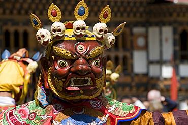 Masked man at the religious festival of Tsechu, Paro district, Bhutan, Asia