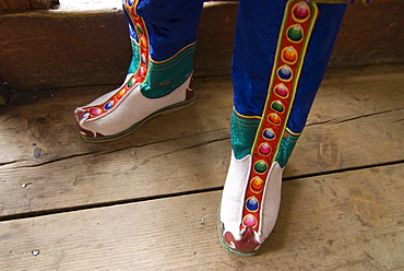 Feet of a monk dressed in traditional costume, Paro, Bhutan, Asia