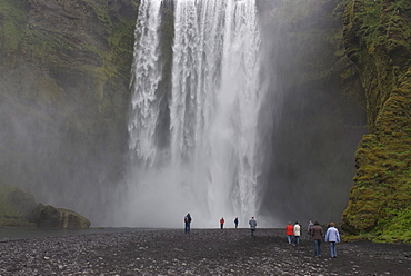 Tourists at the Skogafoss waterfall, Iceland, Europe