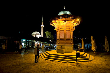 Pedestrian area with a fountain at night, Sarajevo, Bosnia, Europe
