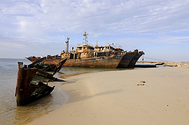 Ship wrecks rusting on the shores of the beach of Nouadhibou, one of the largest ship wreck cemeteries worldwide, Mauritania, northwestern Africa