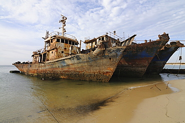 Ship wrecks rusting on the beach of Nouadhibou, one of the largest ship wreck cemeteries worldwide, Mauretania, northwestern Africa