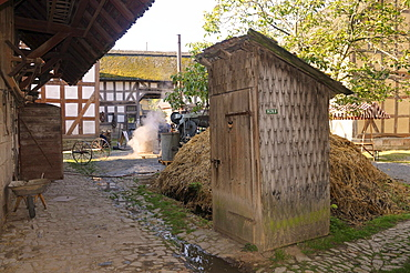 Outhouse, toilet next to the dung heap on a farm, Europa Park near Neu-Anspach, Hochtaunuskreis district, Hesse, Germany, Europe