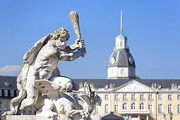 Sculpture in front of Schloss Karlsruhe castle, sculpture focused, Baden-Wuerttemberg, Germany, Europe
