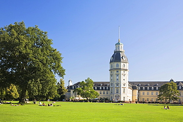 Rear view of Schloss Karlsruhe castle with tower and castle gardens, Baden-Wuerttemberg, Germany, Europe