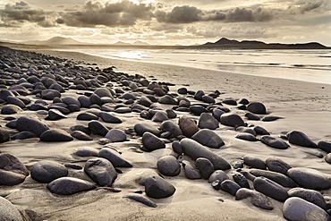 Stones and rocks polished smooth by the sea at Famara Beach, Lanzarote, Canary Islands, Spain, Europe