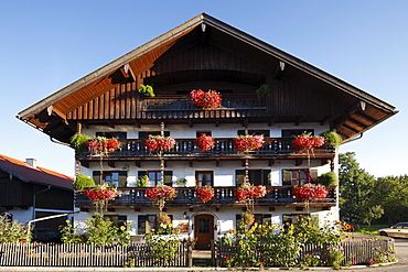 Farmhouse with geraniums on the balconies, Gaissach, Isarwinkel, Upper Bavaria, Bavaria, Germany, Europe