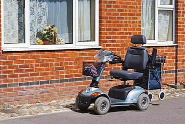 Mobility scooter parked outside a house