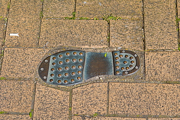 Thomas Tredyngton's footprint in the pavement by Catchcold Tower, medieval city walls, city centre, Southampton, Hampshire, England, United Kingdom, Europe