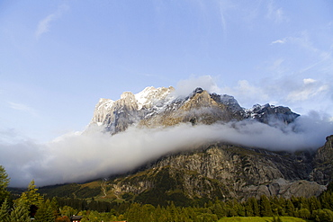 Low clouds on the Wetterhorn mountain, Grindelwald, Bernese Oberland region, canton of Bern, Switzerland, Europe